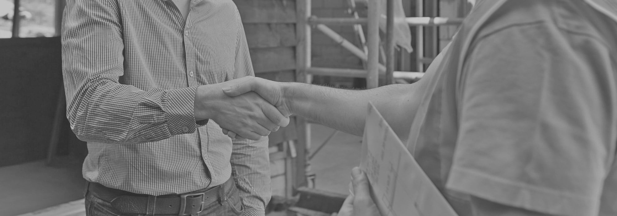 Two people shaking hands with a gray overlay.