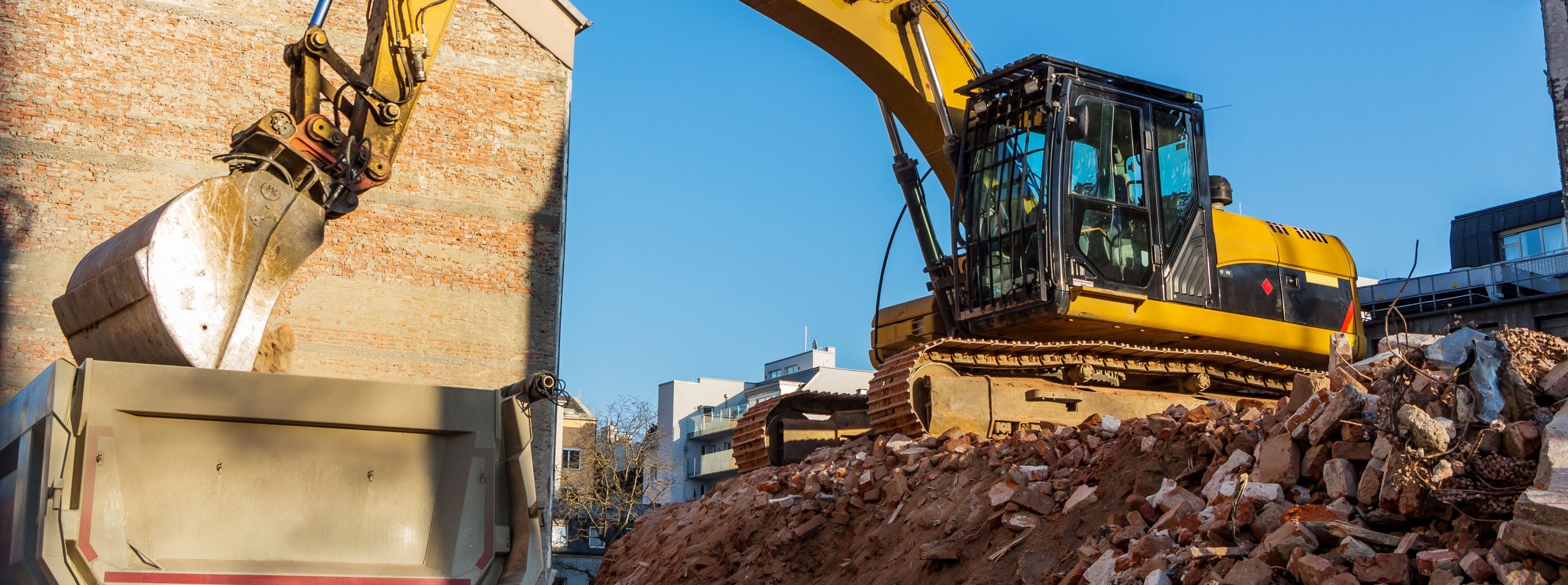 Excavator on a construction site during the demolition of a building